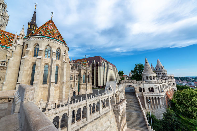 View of Fishermans Bastion and St. Matthias church in Budapest, Hungary Budapest Hungary Europe Travel Travel Destinations Tourism Buda Pest Fishermans Bastion Fishermans Bastion Halászbástya Cityscape Architecture Built Structure Day No People Building Sky Nature City Cloud - Sky St Matthias Church St Matthias Church