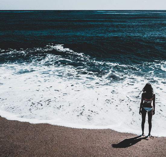 HORIZON, Sea Water Land Beach Real People Lifestyles Beauty In Nature Nature Full Length Leisure Activity Scenics - Nature Wave One Person Rear View Horizon Over Water Horizon Sport Day Outdoors Wave Girl Model Seascape Beauty In Nature