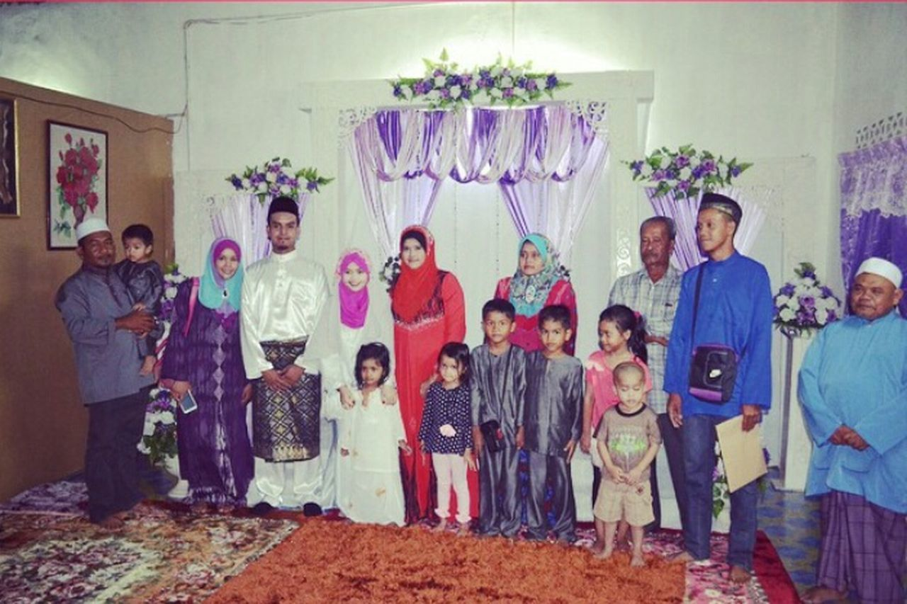 standing, mid adult, mature adult, boys, girls, portrait, togetherness, females, child, women, celebration, adult, indoors, men, looking at camera, people, large group of people, full length, group of people, smiling, childhood, party - social event, human body part, day, young adult, bride