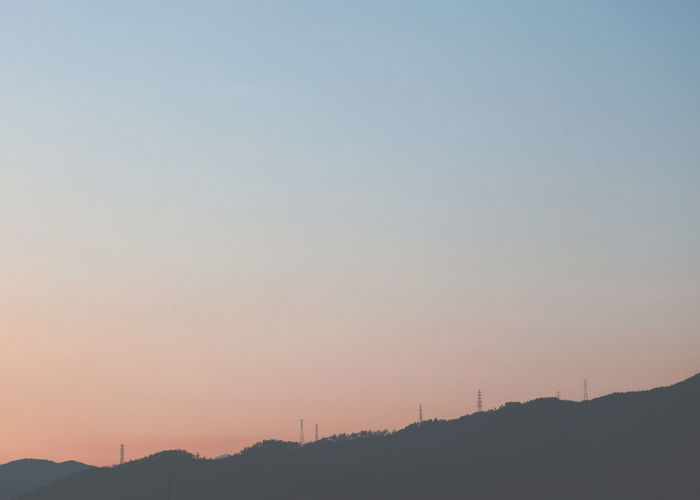 Beauty In Nature Clear Sky Day Landscape Mountain Mountain Range Nature No People Outdoors Scenics Silhouette Sky Sunset Tranquil Scene Tranquility Tree Windmill