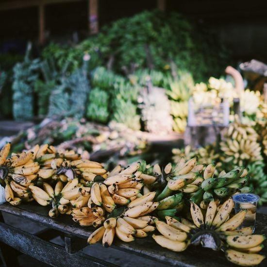 Abundance ASIA Bananas Close-up Colors Day Focus On Foreground Food For Sale Freshness Fruits Green Bananas Healthy Eating INDONESIA Indoors  Large Group Of Objects Maluku  Market Nature Retail  Selling Banana Ternate Traveling Woman Yellow Bananas