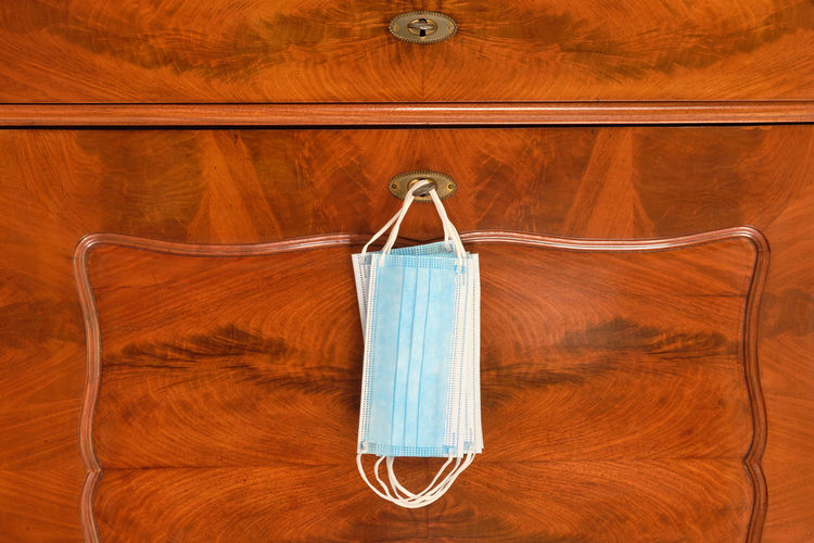 Close-up of clothes hanging on wood