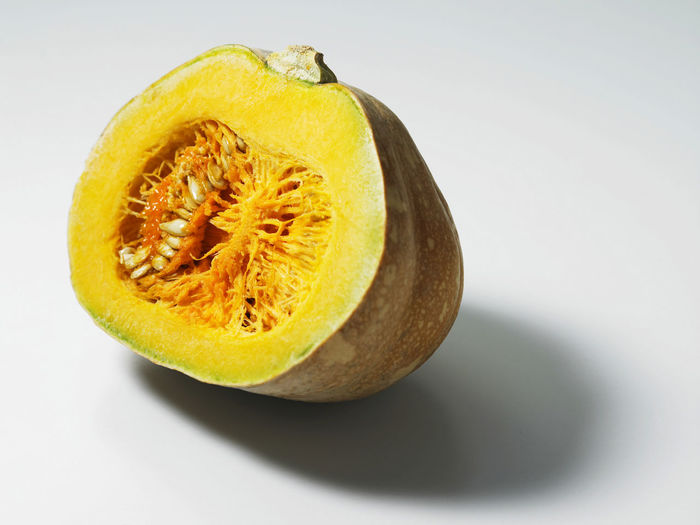 Raw Chopped Close-up Cross Section Cut Out Food Food And Drink Freshness Fruit Halved Indoors  No People Pumpkin Raw Food Ripe Seed Single Object SLICE Slices Still Life Studio Shot Tropical Fruit Wellbeing White Background Yellow