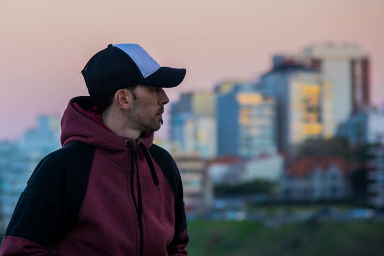 Man Looking At Cityscape During Sunset