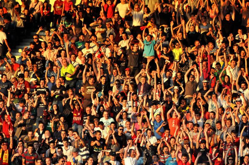 Full frame shot of spectators cheering at stadium