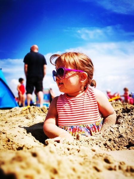 Done That. Beach Sand Sea Sunglasses Summer Childhood Family With One Child ChildEyeEm Selects P10 Plus Photography Bokeh Depth Of Field EyeEm Best Shots Huawei Photography P10 Plus Buried In Sand Fun Vacations Leisure Activity Fun Outdoors . Daughter