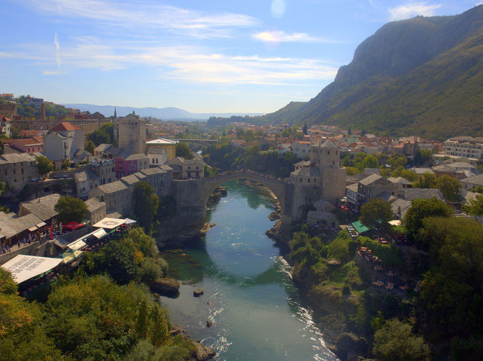 View of the bridge in Mostar from the mosque Bosnia And Herzegovina Mostar Mostar Bosnia Mostar Bridge Architecture Beauty In Nature Bosnia Bridge Building Exterior Built Structure Day Mountain Mountain Range Nature No People Outdoors Scenics Sky Travel Destinations Water