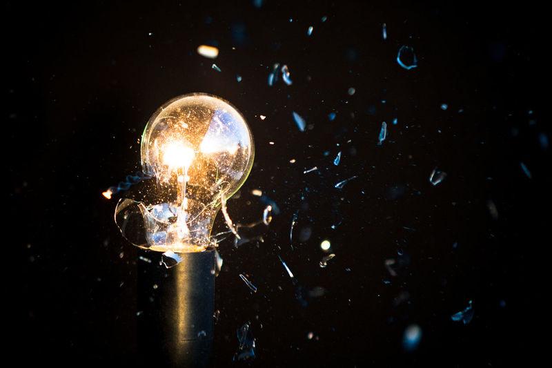 Close-up of light bulb exploding