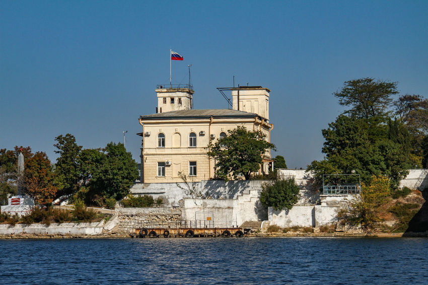 Sevastopol  Architecture Black Sea Building Exterior Built Structure Clear Sky Day Flag No People Outdoors Patriotism Russian Flag Sky Tree Water Waterfront