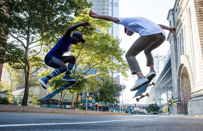 Low angle view of man skateboarding in city