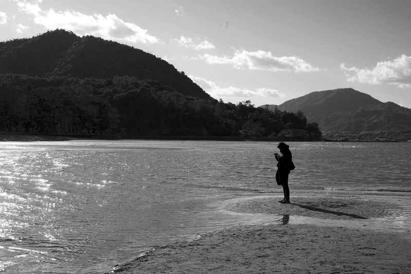 Japan Miyajima Beach Beauty In Nature Day Full Length Land Leisure Activity Lifestyles Men Mountain Mountain Range Nature Non-urban Scene One Person Outdoors Real People Scenics - Nature Sea Sky Standing Water
