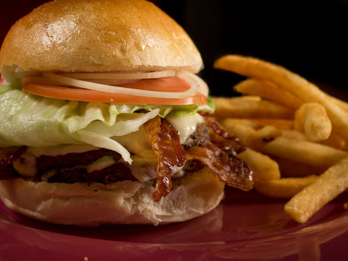 Close-up of fries with burger