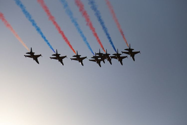 Vapor Trail Airshow Airplane Flying Air Vehicle Low Angle View Teamwork Transportation Smoke - Physical Structure Mode Of Transport Military Airplane Fighter Plane Speed Multi Colored Blue Sky Arrangement No People Outdoors Formation Flying Korean Army Black Eagle
