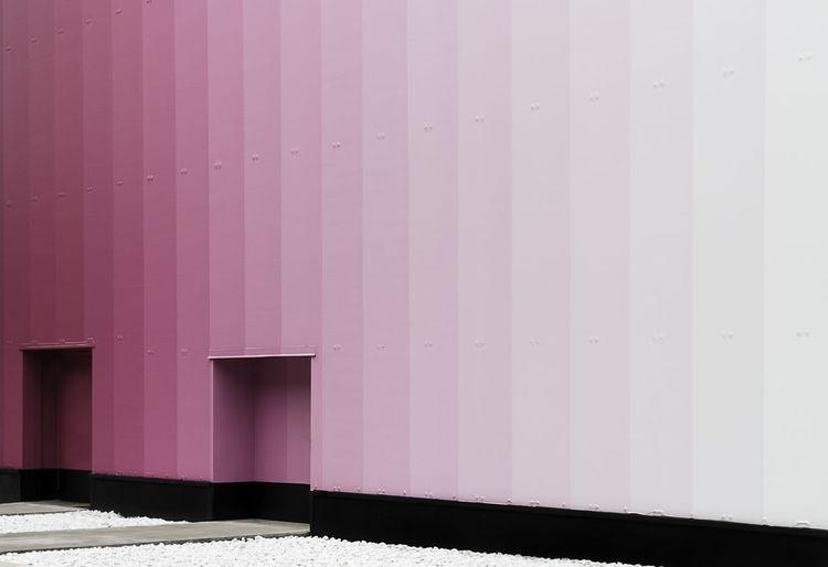 Pink door of building