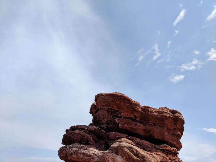 EyeEm Selects Rock Hoodoo Red Rock - Object Blue Tree Sky Close-up Cloud - Sky Eroded Geology Rock Formation Natural Landmark Rock Stack Rock Rocky Mountains Physical Geography Rugged