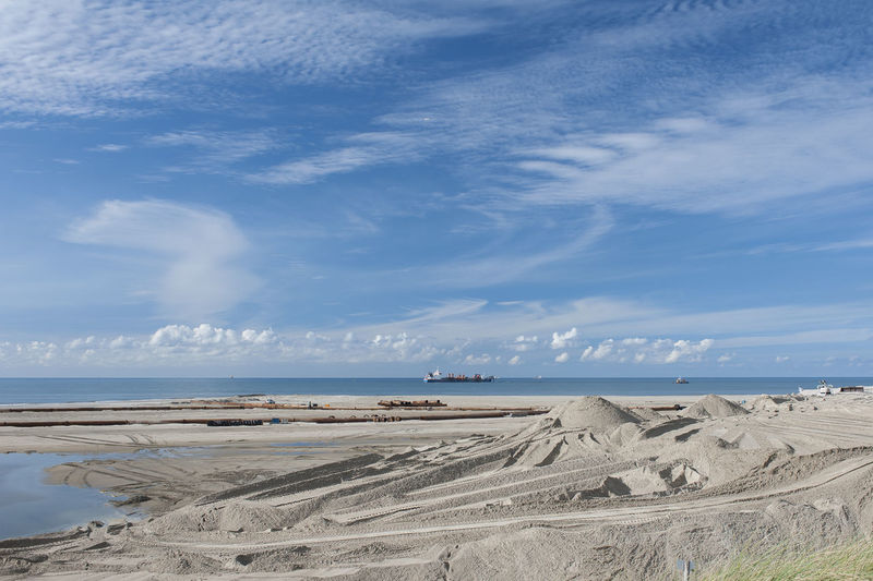 protecting the land Protecting The Dunes Seashore Beach Cloud - Sky Horizon Over Water Reinforcement Sanddunes Sea Water