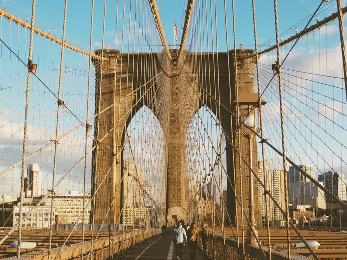 People Walking On Brooklyn Bridge In City