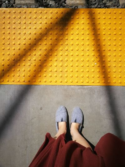 Low Section Of Woman Standing On Railroad Station Platform