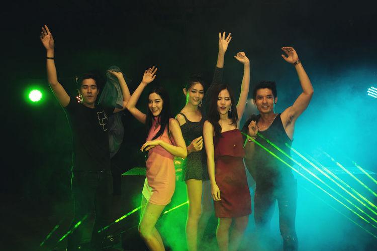 Full length of young woman dancing at night