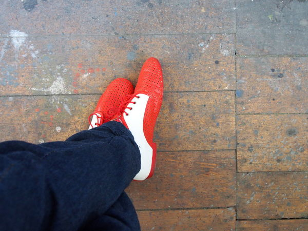 Red Shoes Body Part Casual Clothing Day Directly Above Flooring High Angle View Human Foot Human Leg Human Limb Jeans Leather Shoe Leisure Activity Lifestyles Low Section Oldschool One Person Personal Perspective Real People Red Shoe Standing Style And Fashion Unrecognizable Person Wood
