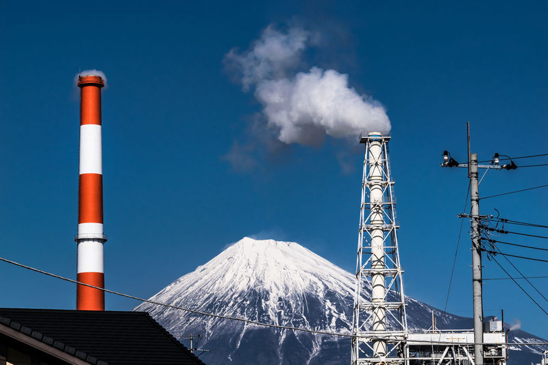 Mt Fuji and a chimney. 富士山と煙突 Chimney Cold Temperature Day Industry Mountain Mt Fuji Natural Disaster No People Outdoors Sky Smoke Snow