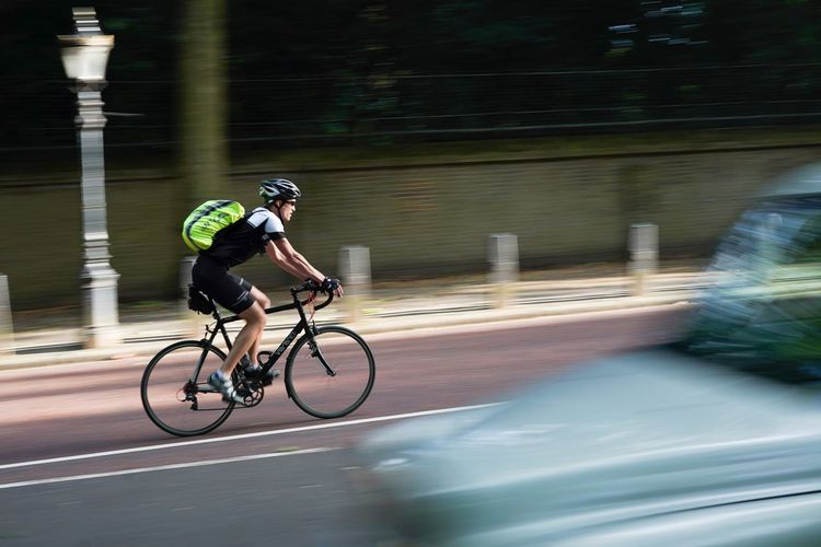 Cyclist Bicycle Speed Motion Blurred Motion Cycling Racing Bicycle Mobility In Mega Cities Transportation Lifestyles Road Headwear Cycling Helmet