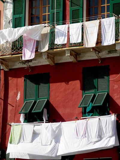 Clothes drying against built structure