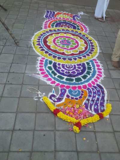 Rangoli on the eve of Indian festivals. Roadside photos. High Angle View Street Multi Colored Tiled Floor Outdoors Day EyeEmNewInHere EyeEmNewHere Rangoli Rangoli Preparations Rangoli Design RangoliArt Rangoli In India Rangoli With Lovely Msz.. Rangolichilipili Rangoli Colours Diyas RangoliArt Diwalicelebrations Festivaloflights Rangoli Time Rangoli . Rangoli Colours Diyas Rangolitime