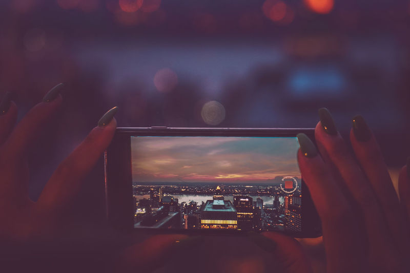 Sunset_collection Bokeh Bokeh Photography Cityscape Communication Device Screen Female Fingers Golden Hour Holding Human Hand IPhone Illuminated Mobile Real People Recording Sunset Technology Wireless Technology