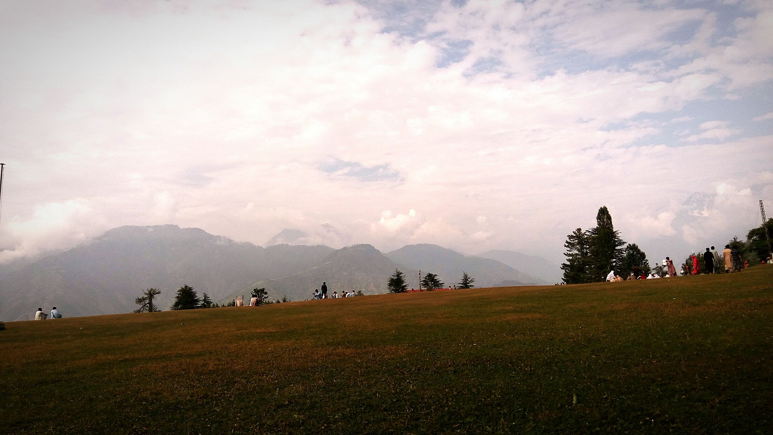 sky, mountain, outdoors, nature, beauty in nature, landscape, tree, sunset, people, day