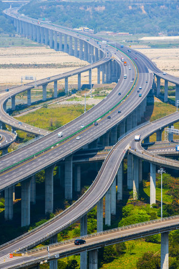 Aerial View Architecture Bridge - Man Made Structure Built Structure Car City Connection Curve Day Elevated Road High Angle View Highway Modern Motion Overpass Road Road Intersection Scenics Speed Street Traffic Transportation Viaduct Wide Winding Road