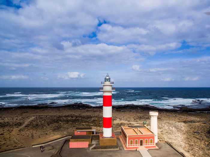 fuerteventura canarian islands spain drone aerial corralejo lighthouse Architecture Sea Beach Water Nature Sky Security Lighthouse Tower Wanderlust Horizon Fuerteventura Land Aerial View Guidance No People Vanlife Dronephotography Horizon Over Water Cloud - Sky Building Exterior Built Structure Aboutpassion DJI Mavic Pro EyeEmNewHere