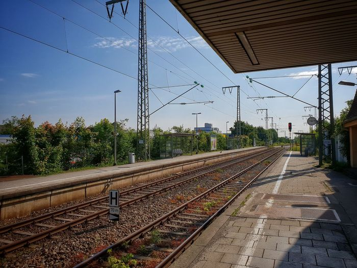 Railroad Track Railroad Station Railroad Station Platform Railway Train Train Station Trainstation Railroad Track Rail Transportation Sky Electricity Pylon Electricity  Cable Electrical Grid Railroad Station Railroad Station Platform Power Line  High Voltage Sign Power Cable