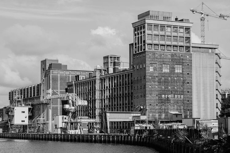 LantarenVenster Rotterdam Architecture Bnw Bnw_architecture Bnwarchitecture Building Crane Exterior Façade Factory Fuji Harbour House Outdoors Sea Water Window Built Structure Building Exterior Sky Cloud - Sky Day No People City Industry Waterfront Fujifilm
