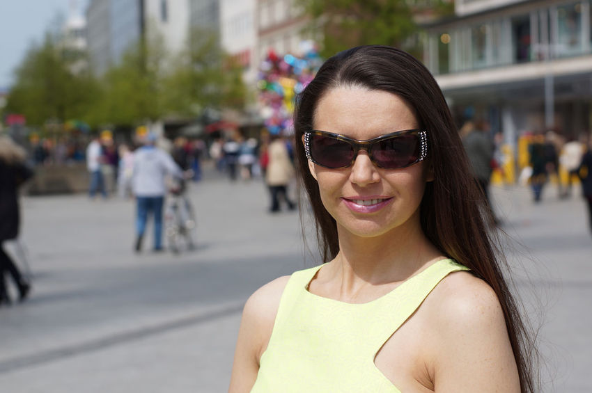 Adult City Downtown Fashion Woman Brunette Day Female Lifestyles Long Hair Looking At Camera Mature Mid Adult Middle Aged One Person Outdoors Pedestrian People Portrait Real People Smiling Street Summer Sunglasses Women