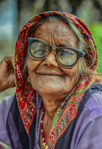 Her smile is just so full of happiness. EyeEm Portraits EyeEm Gallery EyeEmBestPics EyeEmNewHere Portrait Of A Woman Close-up Eyeglasses  Focus On Foreground Front View Happiness Headshot Leisure Activity Lifestyles Looking At Camera One Person One Senior Woman Only Outdoors People Portrait Real People Senior Adult Senior Women Smiling Warm Clothing Women Of EyeEm Fresh On Market 2017