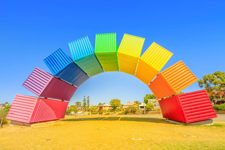 Perth rainbow bridge for visitors welcome. Rainbow Sea Container in Fremantle Port near Perth, Western Australia. Homosexuality and hope concept. Blue sky. Copy space. Freemantle Perth Perth Australia Western Australia Australia Australian Rainbow Bridge Colorful Rainbow Colors Rainbow🌈 Blue Sky Homosexual Love Multi Colored Sky Clear Sky Built Structure Architecture Blue Nature Day No People Green Color Land Outdoors Building Exterior Red Beach Plant Sunlight Sand Shape Copy Space