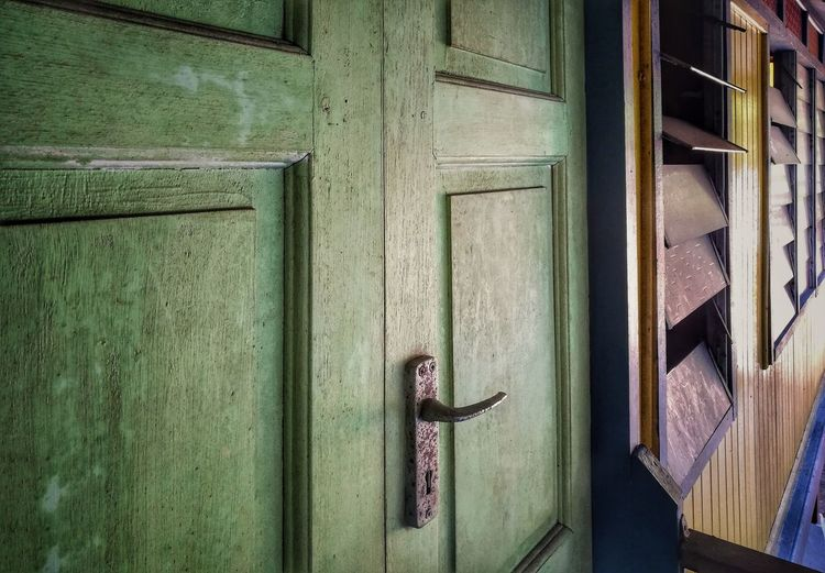 Close-up of green door in front of building