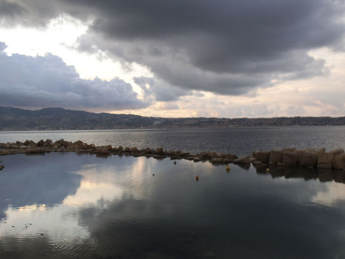 Mare Nuvole Beauty In Nature Bird Cielo Cloud - Sky Day Lake Mountain Nature No People Outdoors Reflection Riflesso Scenics Sky Stretto Di Messina Strettodimessina Tranquil Scene Tranquility Water Perspectives On Nature
