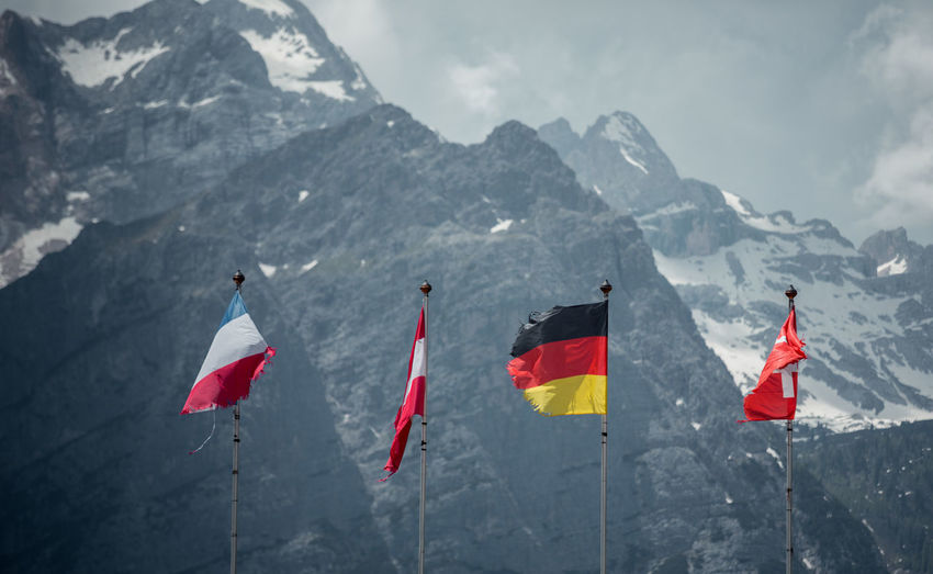 Flags against mountains