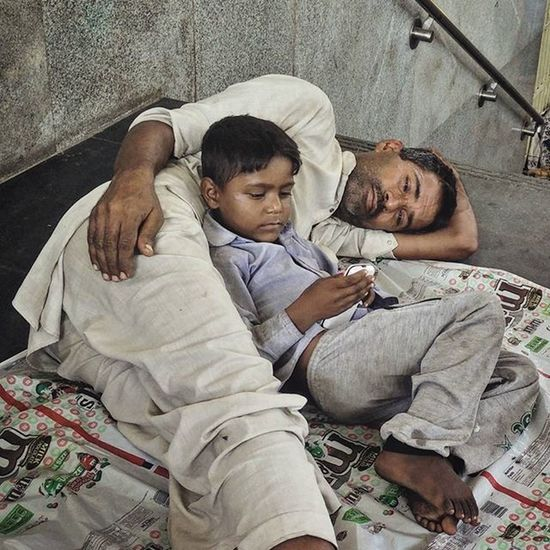 AIIMS Metro 12 Aiimsmetro Umar Singh watches his son play games on his mobile phone at the AIIMS metro station in New Delhi. Singh came to Delhi from Karnal, Haryana, on August 22 to seek treatment for liver infection. He and his family have been staying at the metro station since then. He has been allotted an appointment on September 2. AIIMS metro station, New Delhi, serves as a temporary shelter for the family members of the countless patients undergoing treatment at the All India Institute of Medical Sciences (AIIMS). These people cannot afford to stay at lodges or hotels till their loved ones are treated, thus choosing to dwell at or in the vicinity of the AIIMS metro station. Also, the national capital has thousands who are homeless. Metro stations are one of the commonest spots where the deprived take refuge. Blankets, utensils, kitchen accessories, old cartons, tarpaulin sheets and other household paraphernalia are a common sight at these makeshift shelters. Everydayeverywhere Dailylife Photojournalism Journalism Indiaphotoproject Reportagespotlight _soi Dfordelhi Sodelhi DelhiGram Oneplusone Onepluslife Delhi Newdelhi ASIA India