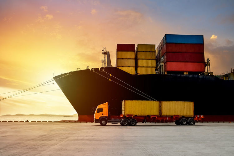 Container Container Ship Dark Delivery Harbor Industrial Logistics Business Cargo Container Freight Freight Transportation Industry Land Vehicle Load Port Ship Shipment Shipping  Sunset Transportation Truck Trucks Vehicle Trailer Vessel
