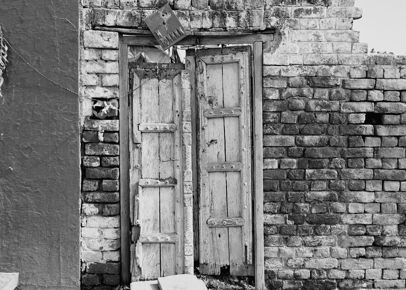 Doors Ruins Oldbuilding Electrical Wires Switches Switchboard Day No People Outdoors Brick Wall Building Exterior Eroded Red Bricks Light And Shadow Blackandwhite