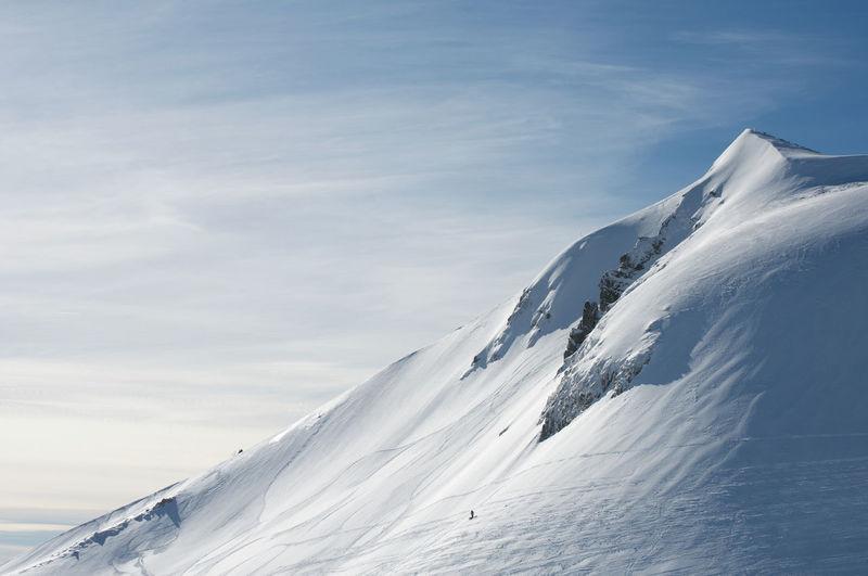 Snowcapped mont sancy mountain against sky in auvergne france