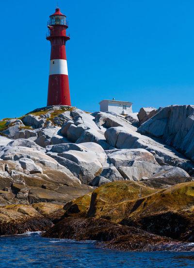 Slåtterøy lighthouse, seen from ocean in the west. Blue Day Lighthouse No People Outdoors Rock - Object Slåtterøy Fyr Water
