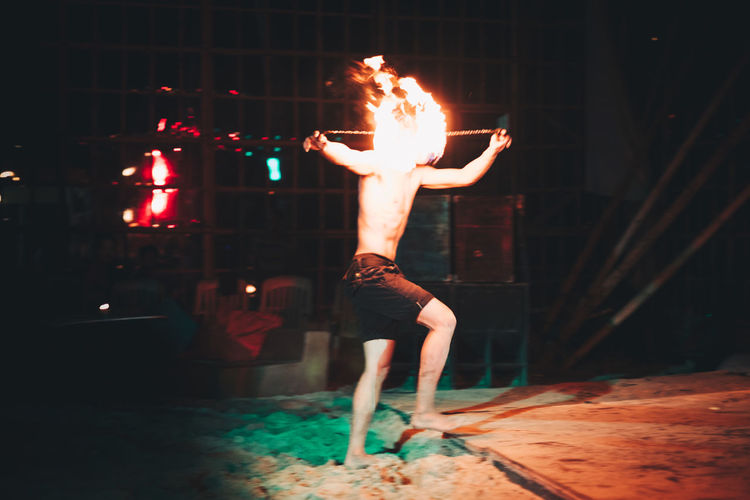 fire dance One Person Only Stunt Arms Raised Burning Dancing Fire Fire - Natural Phenomenon Flame Full Length Heat - Temperature Human Arm Illuminated Leisure Activity Lifestyles Motion Night One Person Performance Real People Shirtless Skill  Stage Unrecognizable Person Warning Sign Young Adult Be Brave Summer In The City This Is Strength Autumn Mood The Modern Professional The Art Of Street Photography