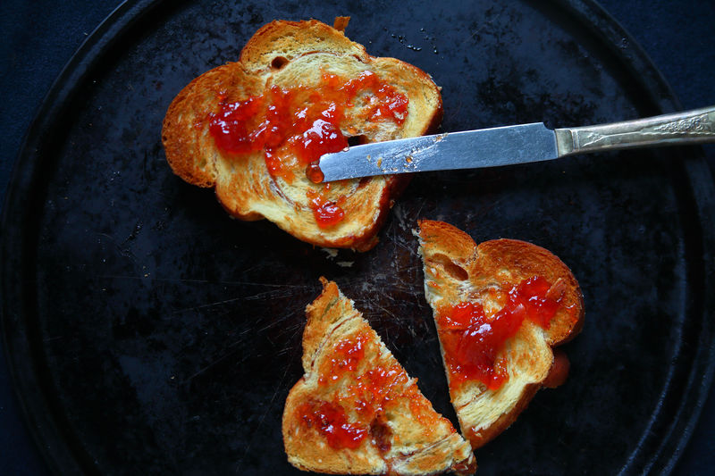 Spreading strawberry jam on toast Food Freshness Indoors  Ready-to-eat No People Directly Above Close-up Healthy Eating Bread Snack Breakfast Toast Strawberry Jam Copy Space Room For Text Studio Shot Dinner Knife Red Tasty Sweet Natural Light Textures