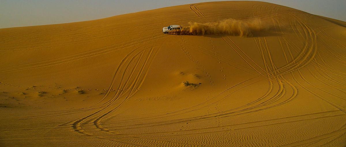 Distance Shot Of Vehicle At Desert