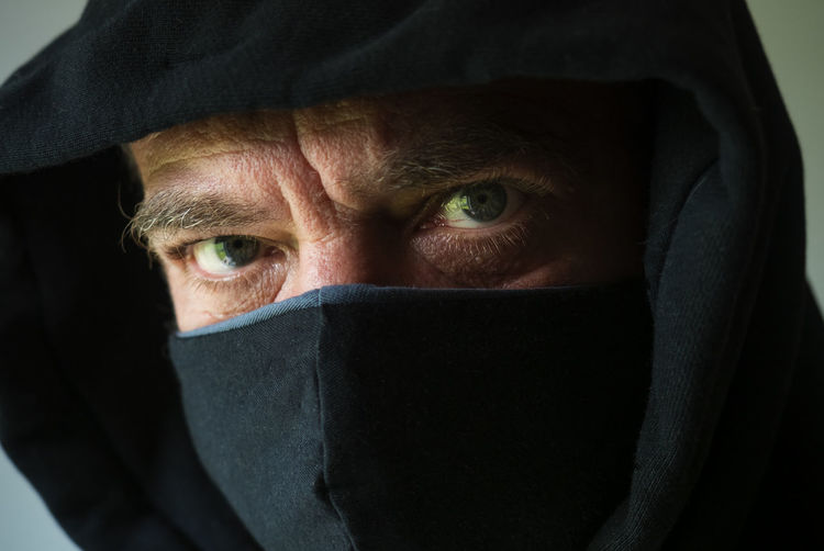 Close-up portrait of mid adult man covering face
