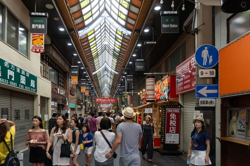 Kuromon ichiba market. Eating Food And Drink Japan Japanese Food Japanese Market Japanese Style Kuromon Ichiba Market Market OSAKA Shopping Travel City Eat Food Food Photography Group Of People Large Group Of People Lifestyles Real People Script Shop Sign Store Text Walking